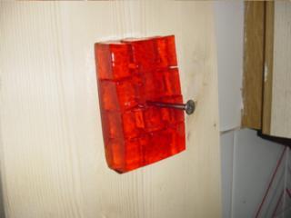 Orange_jelly_nailed_to_wall